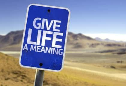 "Sign in desert reading ""Give Life A Meaning."""